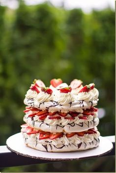 Light Chanitlly Cream & fresh fruit sandwiched between meringue cake layers, all brought together by the chocolate drizzle, you will not want to stop with one slice! Pavlova Cake, Pavlova Recipe, Sweet Recipes, Cake Recipes, Dessert Recipes, Fun Desserts, Delicious Desserts, Yummy Treats, Sweet Treats