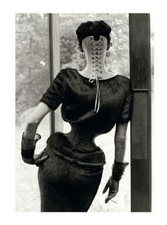 The Discipline of Fashion, Stella Tennant photographed by Steven Meisel for Vogue Italia September 2011. [i wonder how digitally enhanced this is  - it must take *years* of waist training to achieve a waist that miniscule!]