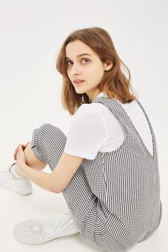 Gingham is so on trend right now. We love the retro print on this slouch jumpsuit, featuring v-neck, front pockets and tapered rolled-up legs. Layer over a simple t-shirt for a '90s feel.