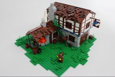 Here are some nice LEGO versions of essential medieval buildings from Age of Empires II by a group of LEGO enthusiasts. An Archery Range by Mark of Falworth and Barracks by Andrew JN above, and a few more below. Age Of Empires, Lego Age, Lego Christmas, Medieval Houses, Blacksmith Shop, Lego Castle, Lego Projects, Lego Building, Lego Brick