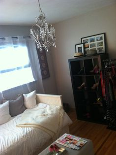 Turn a spare bedroom into a wardrobe room. Ikea daybed, chandelier,and shelving for shoes. Sherwin Williams Popular Grey. My new favorite room in our house!
