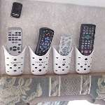 Soap holders organize remotes in an RV.