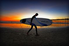 Surfer and Oceanside Pier at Sunset - October 28, 2012 by Rich Cruse, via 500px