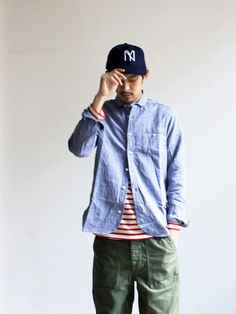Club collar, stripe and supply pocket pant. Classic color combo.