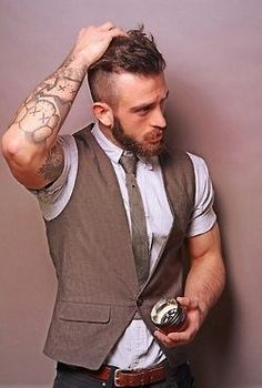 Waistcoat and tattoos.