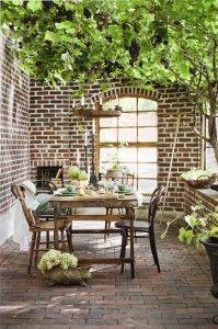 Greenhouse – plates, tablesetting, grapes in the roof, greenhouse of bricks, summer table setting, for the swedish magazine #skönahem. Stylist: Johanna Flyckt Gashi, Photographer: Lina Östling