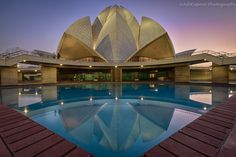 The Lotus Temple, located in New Delhi, India, is a Baha'í House of Worship completed in 1986. Notable for its flowerlike shape, it serves as the Mother Temple of the Indian subcontinent and has become a prominent attraction in the city. The Lotus Temple has won numerous architectural awards and been featured in hundreds of newspaper and magazine articles.   Photo: Ash Kapoor Photography