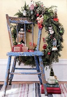 A charming vignette can happen anywhere -- even on a chair as seen here in a rustic Christmas display....