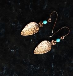 These lovely copper teardrop embossed earrings were handcafted from copper sheet and entirely handmade. There are 6mm Turquoise rondelle beads just below the Gold Filled ear wires. Turquoise and coppe
