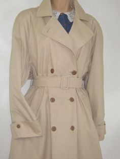L A U R A A S H L E Y  I dont like ephemeral things, I like things that last forever  A BRITISH CLASSIC FROM 1990, THIS RARE, DOUBLE-BREASTED COTTON TRENCH COAT IN STONE BEIGE HAS RETAINED ITS TIMELESS APPEAL. HORN-EFFECT BUTTONS FASTEN THE FRONT WITH INSIDE BUTTON TO KEEP SECURE SHAPE. THE LONG LAPEL CAN BE BUTTONED RIGHT UP TO THE NECK WITH HIGH FOLDING COLLAR TO PROTECT FROM WET/WINDY WEATHER. THE ATTRACTIVE BACK FLAP STORM COVER ADDS FURTHER PROTECTION. SOFT SHOULDER PADS GIVE A SHAR...