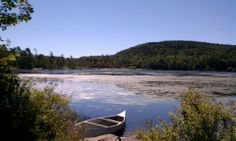 Canoe on the shore at North South Lake Campground - NYSDEC Campgrounds