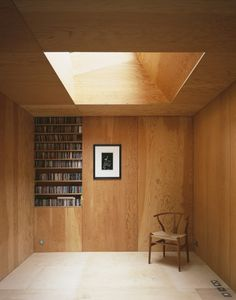 Frame House | Jonathan Tuckey Design, Holland Park, London, UK - A small interior detail such as the Hans Wegner wishbone chair perfectly compliments the douglas fir paneling and is a simple integration of both contemporary design and craftsmanship.