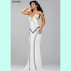 💟 Jovani Jersey Gown Beautiful spaghetti strap jersey dress features a v-neckline and beaded adornments! Size 6 in stock!  Other sizes might be available for order! There is about 10 white beads missing from the row of white beads!  You can not see that these are missing whatsoever, I only know they are because it happened when someone was trying it on. Jovani Dresses Prom