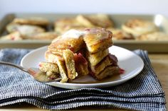 Strawberry cornmeal griddle cakes - These are a perfect way to use those overripe too fast strawberries from the market that I secretly love most of all for cooking, as they're insanely sweet and practically collapsed even before they hit the oven. Click through for recipe!