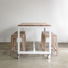The Farmhouse Modern Island provides a functional work surface with ultimate flexibility. This counter-height piece was conceived of as a freestanding kitchen unit that can be rolled out of the way, o