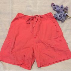 Beautiful, Coral Colored Shorts by White Stag Flattering, Coral colored shorts perfect for the summer! Front has cute drawstring waist with pockets on the side. Back has elastic waistline and 2 back pockets. 100% Cotton & perfect for travelingLadies Size 6, seems true to size ❌No Trades ❌ Reasonable Offers Only  ✅ Bundle & Save ✅ White Stag Shorts