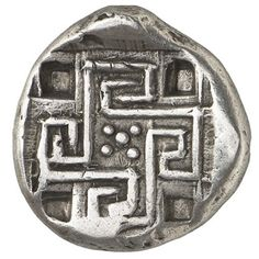 Minotaur and Labyrinth Coin from Gortyn, CreteSilver stater struck in Gortyn circa 425-360 BC Obverse: Minotaur in a kneeling-running stance to right, its head facing Reverse: Labyrinth, in the form of a swastika, five pellets in a floral pattern at...