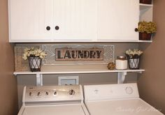 I like the cabinets with the shelf under it...much better than the wire shelves that are in my laundry room now.