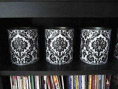 Tin Cans made pretty...I like this for a way to make nice looking storage containers for our home.