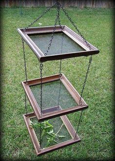 A very handy herb dryer made from old picture frames, chain and insect screen