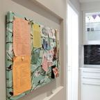 A small bulletin board is a handy addition to the laundry room. Use it to keep stain removal charts where they can be easily referenced, and pin up a clear plastic envelope to hold random things found in the wash.
