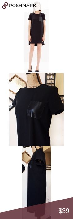 """MADEWELL Black Faux Leather Pocket T-Shirt Dress Madewell Faux Leather Pocket Black T-Shirt Dress. Sheath Style and Relaxed Fit, adorned with a Faux Leather Chest Pocket. Middle Back Neck Zip Closure. Asymmetrical Hemline. Falls 36"""" from Shoulder to Hem. 100% Polyester. Size X-Small. NWOT. Madewell Dresses"""