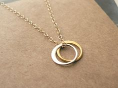 sun and moon tiny gold and silver circle necklace is it weird that i would - Wedding Ring Necklace