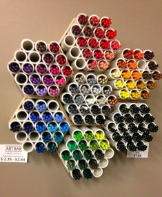 I saw this at Jerry's Artarama Art Bar last week to hold colored pencils....It is cut tubes of PVC pipe glued together in holder. I thought it was really cool and could be adapted to hold bruses or paint tubes too,