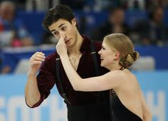 Canada's Kaitlyn Weaver and Andrew Poje react during the Figure Skating Ice Dance Free Dance Program at the Sochi 2014 Winter Olympics