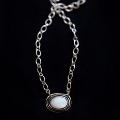 """This """"Halcyon"""" stamped necklace is the perfect gift for a going away present or a sympathy gift. The word halcyon means to remember a happy or peaceful time in your past. It would make a meaningful and beautiful present. Center stone is mother of pearl."""