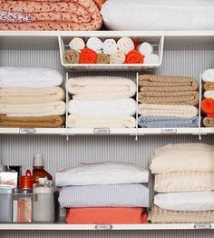 Shelf dividers, and hanging shelves and sheets stored in pillowcase and those cute labels on the shelf edges.