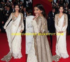 Saree Designz: Sonam Kapoor in White Saree paired with Long Shrug at Cannes 2013