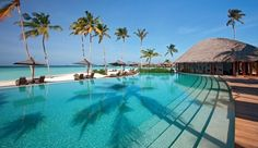 Constance Halaveli Resort: The serene pool runs parallel to the Indian Ocean.