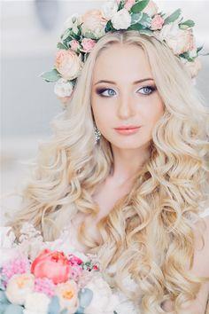 bloned long wavy wedding hairstyle with pastel flower crown / http://www.deerpearlflowers.com/25-romantic-long-wedding-hairstyles-using-flowers/