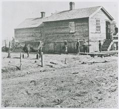 The O'Leary property, or a similar homestead, c. 1870. At the time, farm animals were commonly kept within city limits to provide their owners with fresh milk, butter, eggs, and other products to eat or sell. ICHi-33547