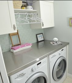Laundry room. Love the subway tile backsplash and stainless steel counter | Stinky Towels? | Smelly Laundry? | http://WasherFan.com | Permanently Eliminate or Prevent Washer & Laundry Odor with Washer Fan™ Breeze™ | #Laundry #WasherOdor  #SWS