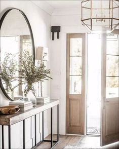 Modern Farmhouse Entry Styling – Entrance style in a modern farmhouse – Here is some information about modern lifestone and wood are a must for modern rustic spacesRustic floral decoration in a shabby chic style Decoration Hall, Decoration Entree, Entryway Decor, Entryway Ideas, Hallway Ideas, Entryway Mirror, Entry Table Mirror, Entryway Stairs, Front Hallway