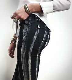 White fabric paint + tight black skinny-jeans= HOT new trendy look for less!! Add bold statement jewelry and attitude and rock this look that no one will know was DIY!