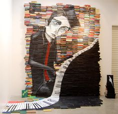 Mike Stilkey creates unique art by painting on the sides of stacked books.