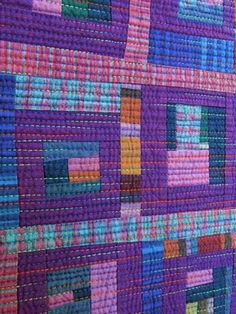 Nice colors and like the straight line quilting.