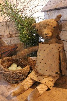 Prim Tattered Teddy...a fine farmhouse.