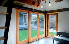 A tiny guest house/studio+home office seems larger than it is with a wall of moveable windows using Krown Lab's ROB ROY sliding barn door system. http://krownlab.com