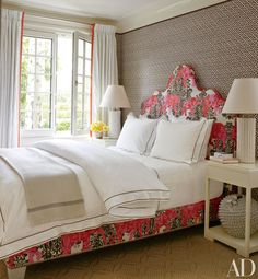 A China Seas fabric sheathes the walls of a guest room in retail entrepreneur Christopher Burch's Hamptons home, which was decorated by Christopher Maya; the bed and custom-made headboard are clad in a fabric from Country Swedish, the bedding is by Matouk, the lamps are from Treillage, and the carpet is by Merida Meridian.