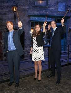 Prince Harry, Catherine, Duchess Kate and Prince William raise their wands on the #WarnerBros set used in the Harry Potter Films - April 26, 2013