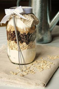 {Day 24: Give Neighbor Gifts} These Chocolate and Oatmeal Cookies in a Jar are a perfect neighbor gift during the holidays. What type of neighbor gifts do you give? /// Download the full Service eBook here: momitforward.com/...