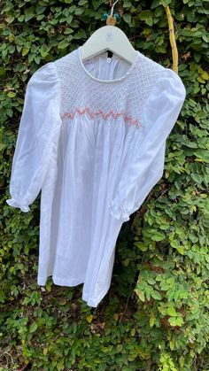 This cotton pure white full sleeved dress has an intricately hand embroidered smocked yoke combined with bullion flowers that enhances the beauty of the smocked yoke. An easy pull up zip on the back makes life easy for the little ones and mammas. Comfy to wear on cold days or an evening do. Sleeved Dress, Cute Baby Clothes, Cold Day, Baby Shop, Pure White, Cotton Dresses, Dress Collection, Smocking, Dress Skirt