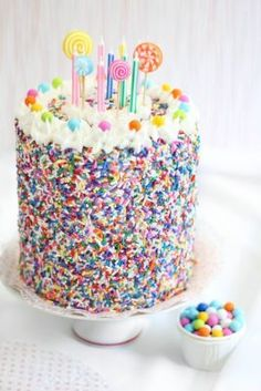 Sprinkle Bakes: Rice Krispie Treat Sprinkle Cake - Love how this cake is decorated.inspiration for a real cake Pretty Cakes, Cute Cakes, Yummy Cakes, Candy Cakes, Cupcake Cakes, Lollipop Cake, Rice Krispies, Krispie Treats, Birthday Cake Alternatives