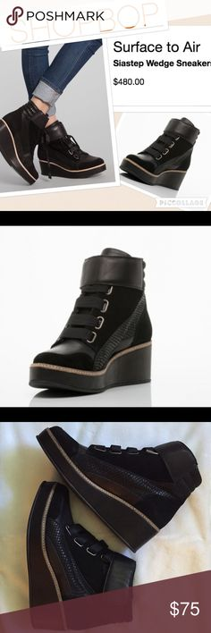 Surface To Air Siastep Wedge Sneaker Boot 8 8.5 The say size 40 but they fit like size 8. NWT. New! Surface to Air reveals the casual moonstep-inspired Siastep wedge for Fall. This hiigh-top leather platform is the epitome of Wedges You Wear Everywhere. Contrasting panels of snake-textured leather and suede leathers comprise the detailed upper, stationed atop a super do-able, leather-wrapped wedge. You don't find shit like this at your mall. Wear with skinny jeans, loose sweaters and aviator…