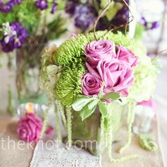 Green mums, pastel lavender roses, white hydrangeas, varigated pitt, and green amaranthus.