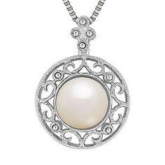 Bezel-set freshwater pearl in vintage-inspired sterling silver.